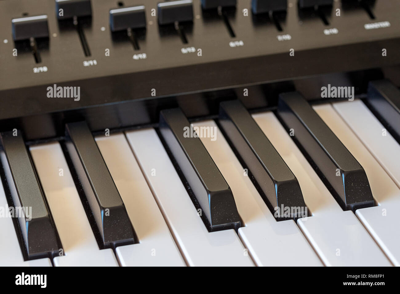Midi keyboard synthesizer piano keys closeup for electronic music production - Stock Image