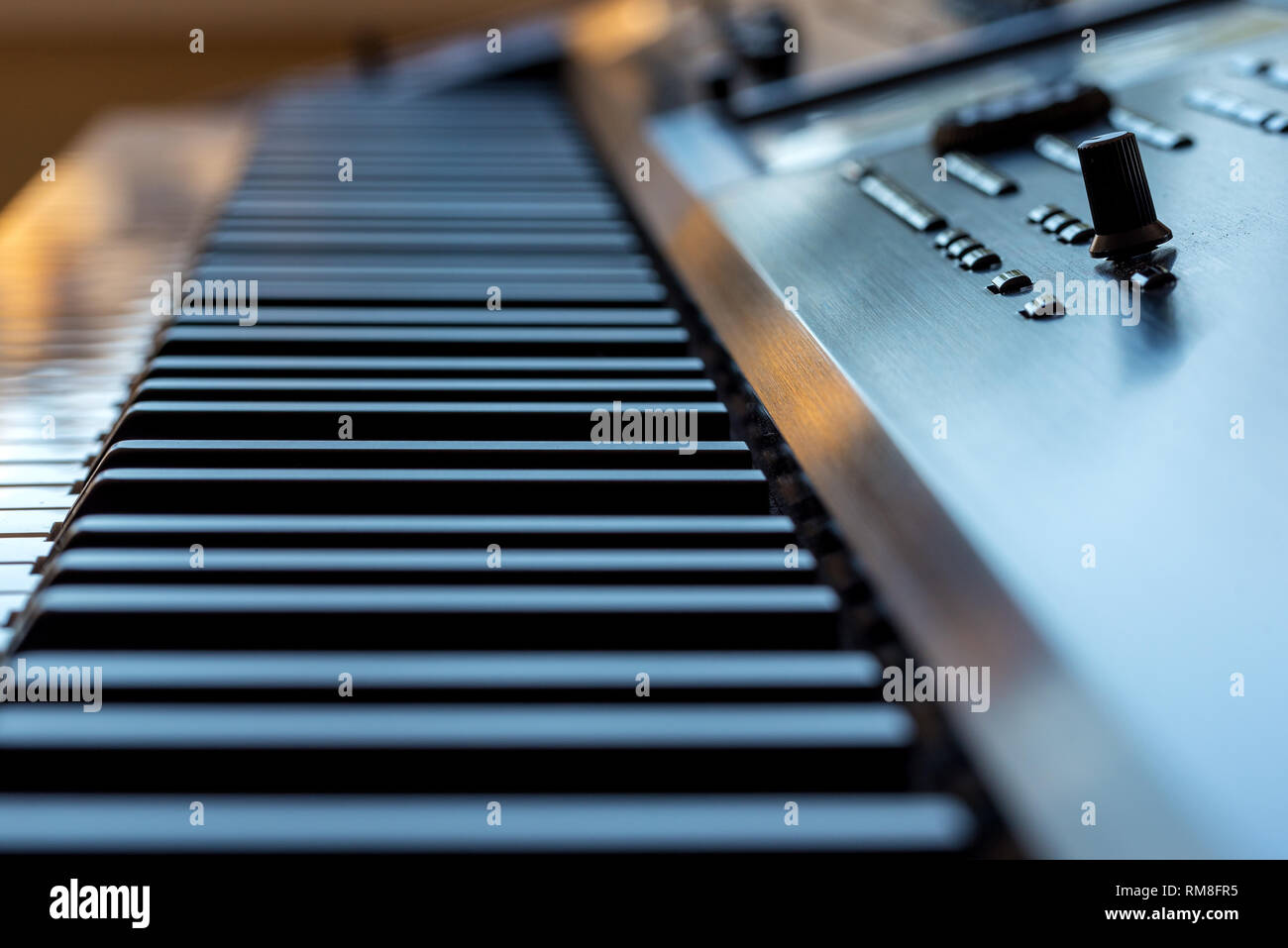 Midi keyboard synthesizer piano keys closeup for electronic music production - Stock Image