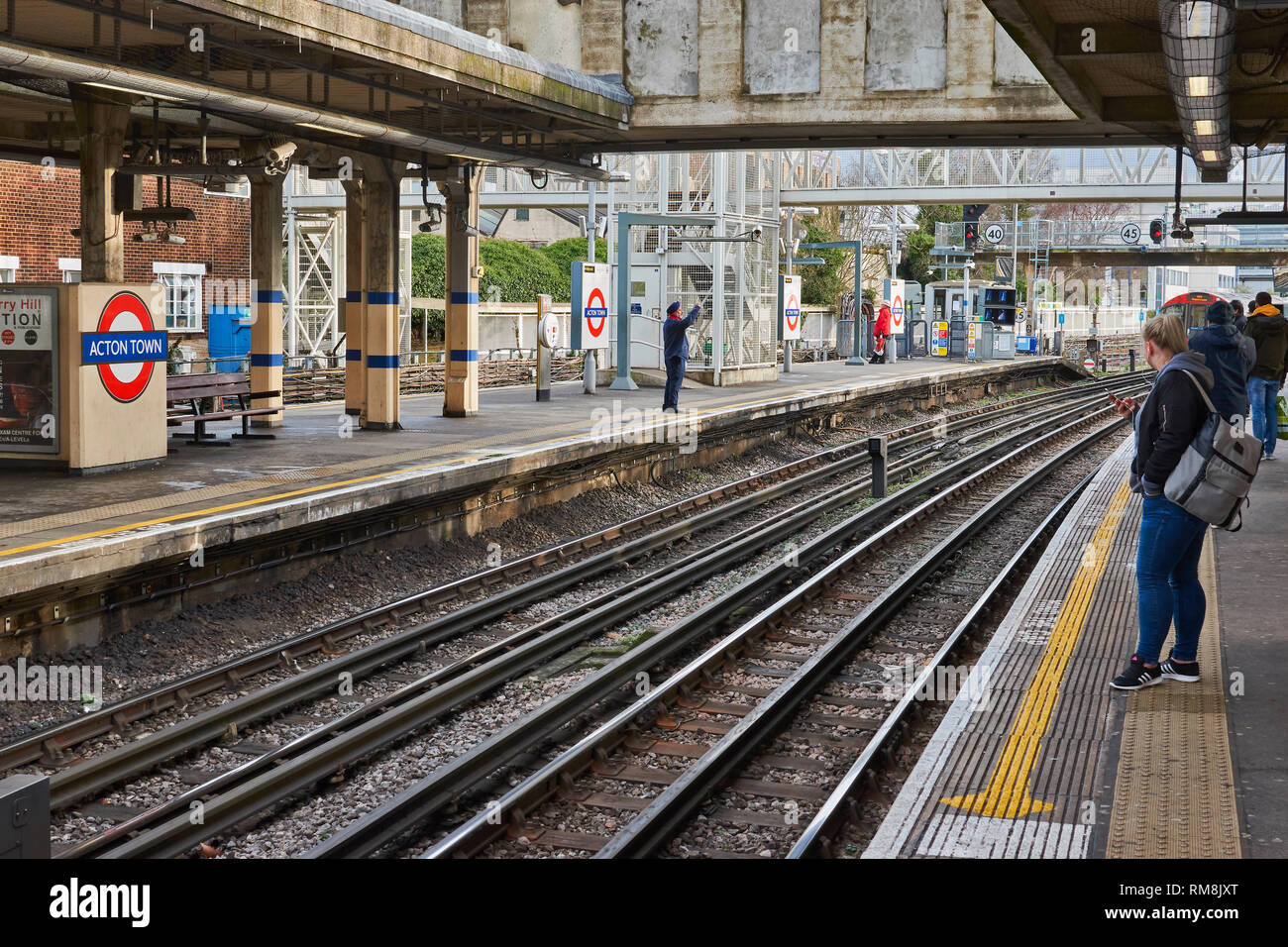 LONDON UNDERGROUND OR TUBE TRAIN ARRIVING AT ACTON TOWN STATION ON PICCADILLY LINE - Stock Image