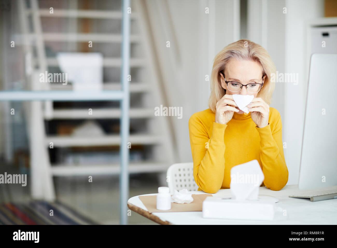 Sick Businesswoman at Work - Stock Image