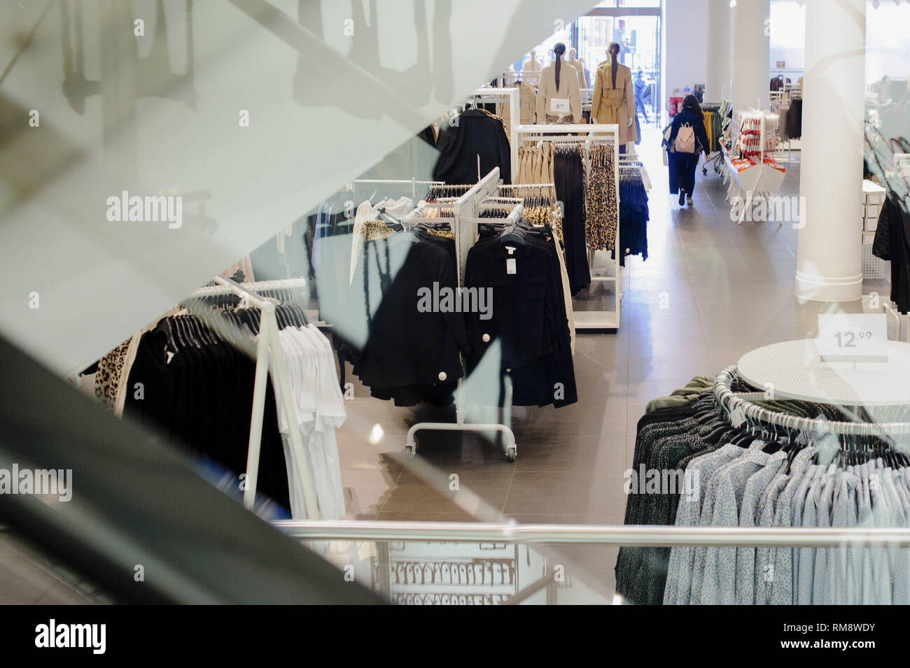 A woman seen shopping inside the Regent Street branch of clothing retailer H&M in central London. February 15 sees the release of the first monthly retail sales figures of the year (for January) from the UK's Office for National Statistics. December figures revealed a 0.9 percent fall in sales from the month before, which saw a 1.4 percent rise widely attributed to the impact of 'Black Friday' deals encouraging earlier Christmas shopping. More generally, with a potential no-deal departure from the EU growing nearer and continuing to undermine consumer confidence in the UK, economy-watchers hav - Stock Image