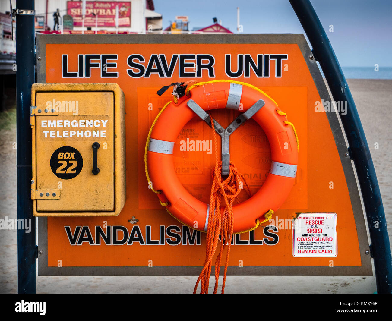 Life Saving Equipment - Life Saver Unit on Great Yarmouth Beach in Norfolk UK with vandalism notice - Stock Image