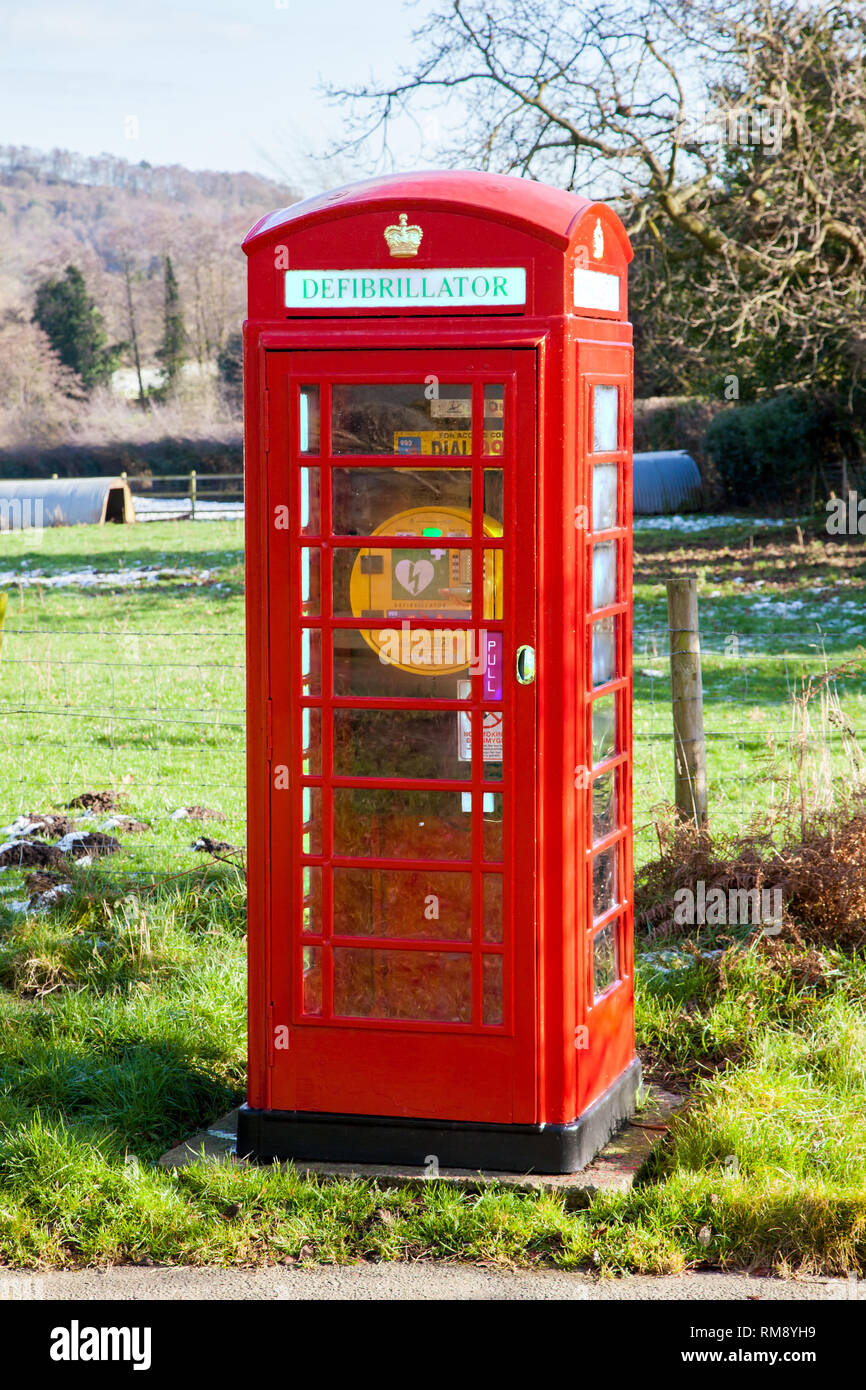 Telephone box kiosk now used as a defibrillator station point in the Cheshire countryside at the village of Brown Knowl in the Bickerton Hills - Stock Image