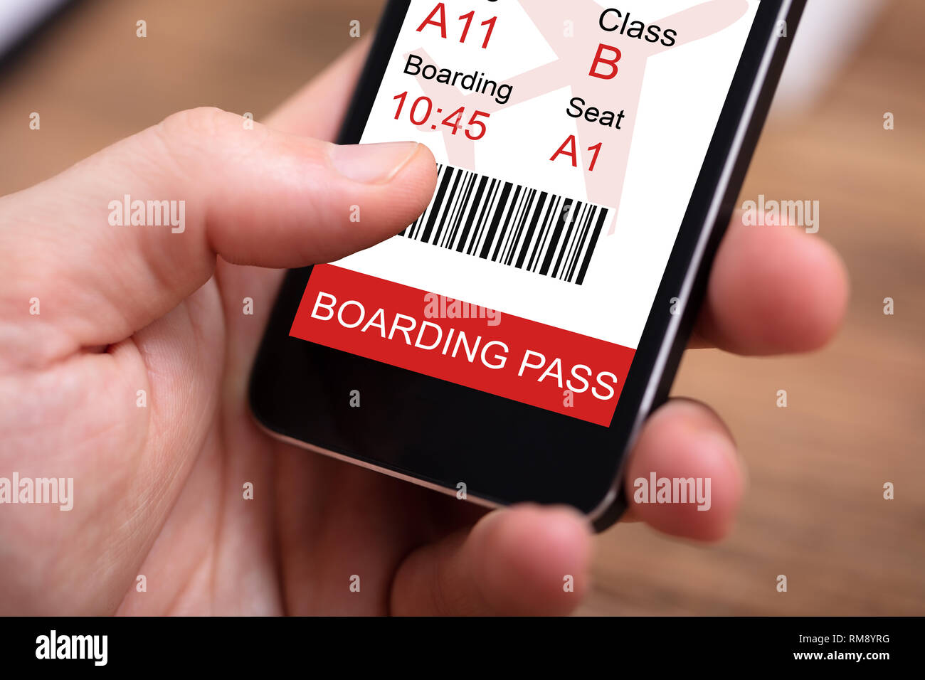 a80da610abe Person Holding Mobilephone With Boarding Pass On Screen - Stock Image