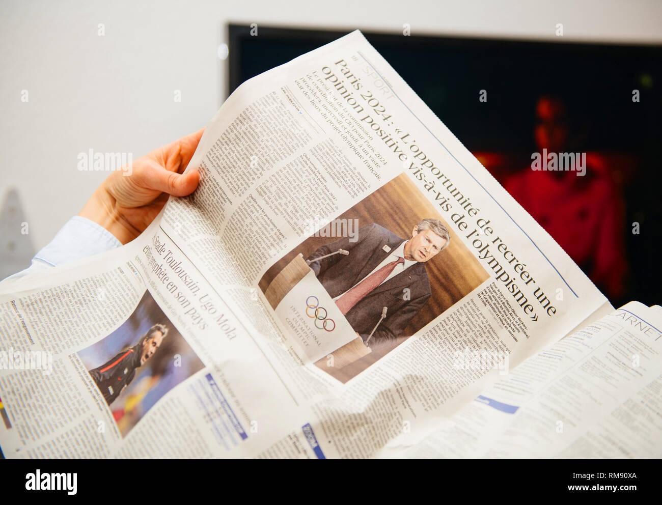 Paris france dec french woman reading le figaro