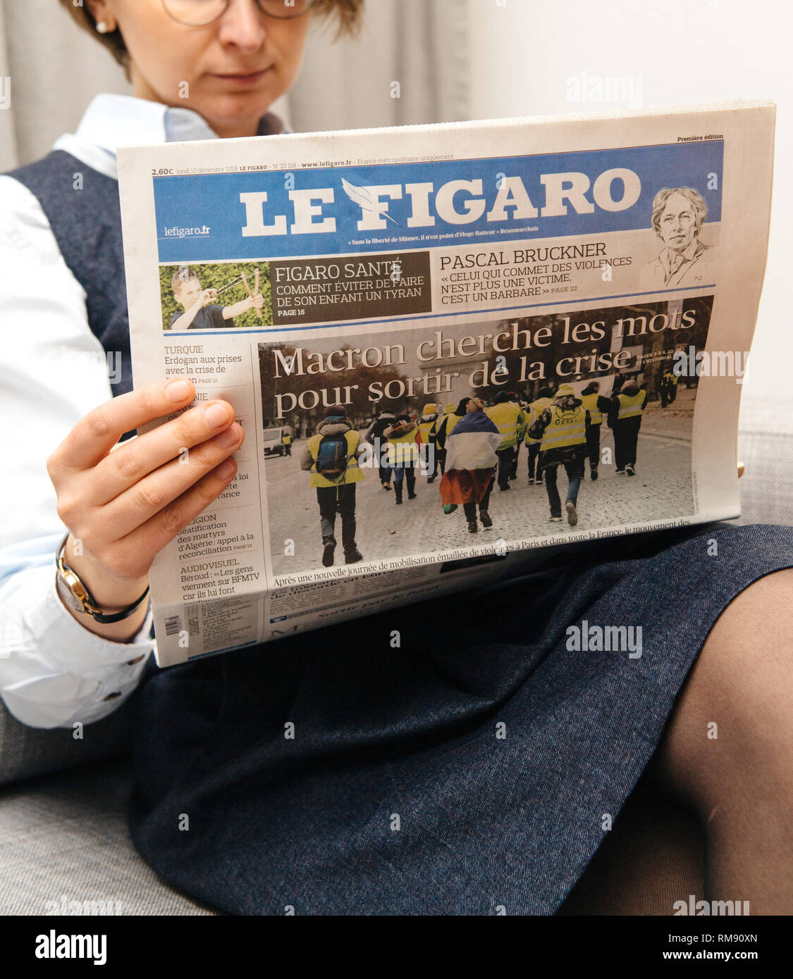 Paris, France - Dec 18, 2018: French woman reading Le Figaro