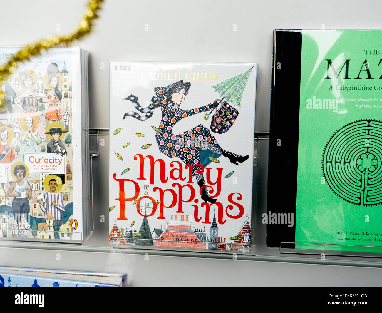 Paris, France - Dec 16, 2018: View from the street of bookstore stand with cover of Mary Poppins illustrated by Lauren Child - Stock Image