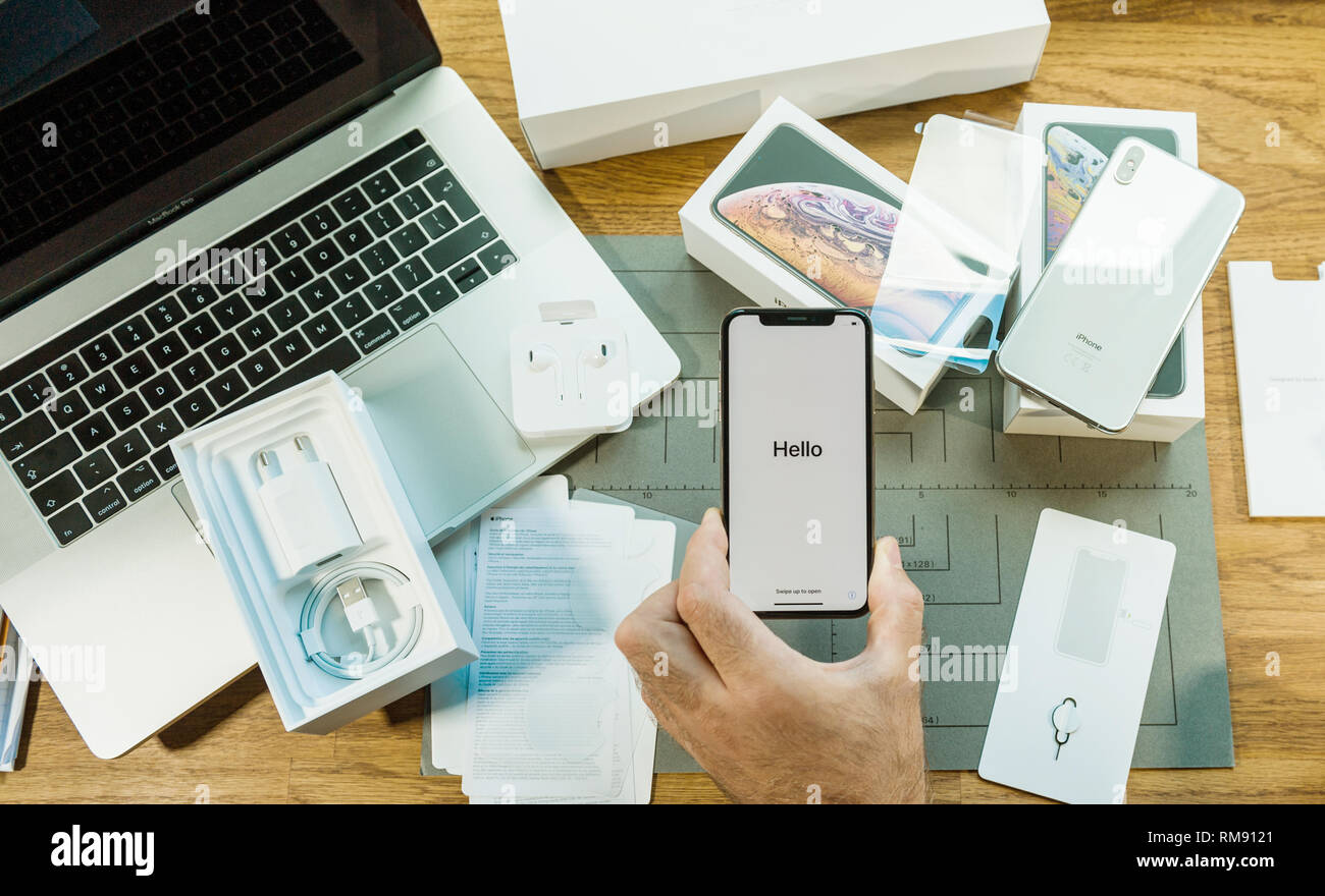 PARIS, FRANCE - SEPT 24, 2018: man first run onf Apple iphone XS and XS Max with Hello message during setup - Stock Image