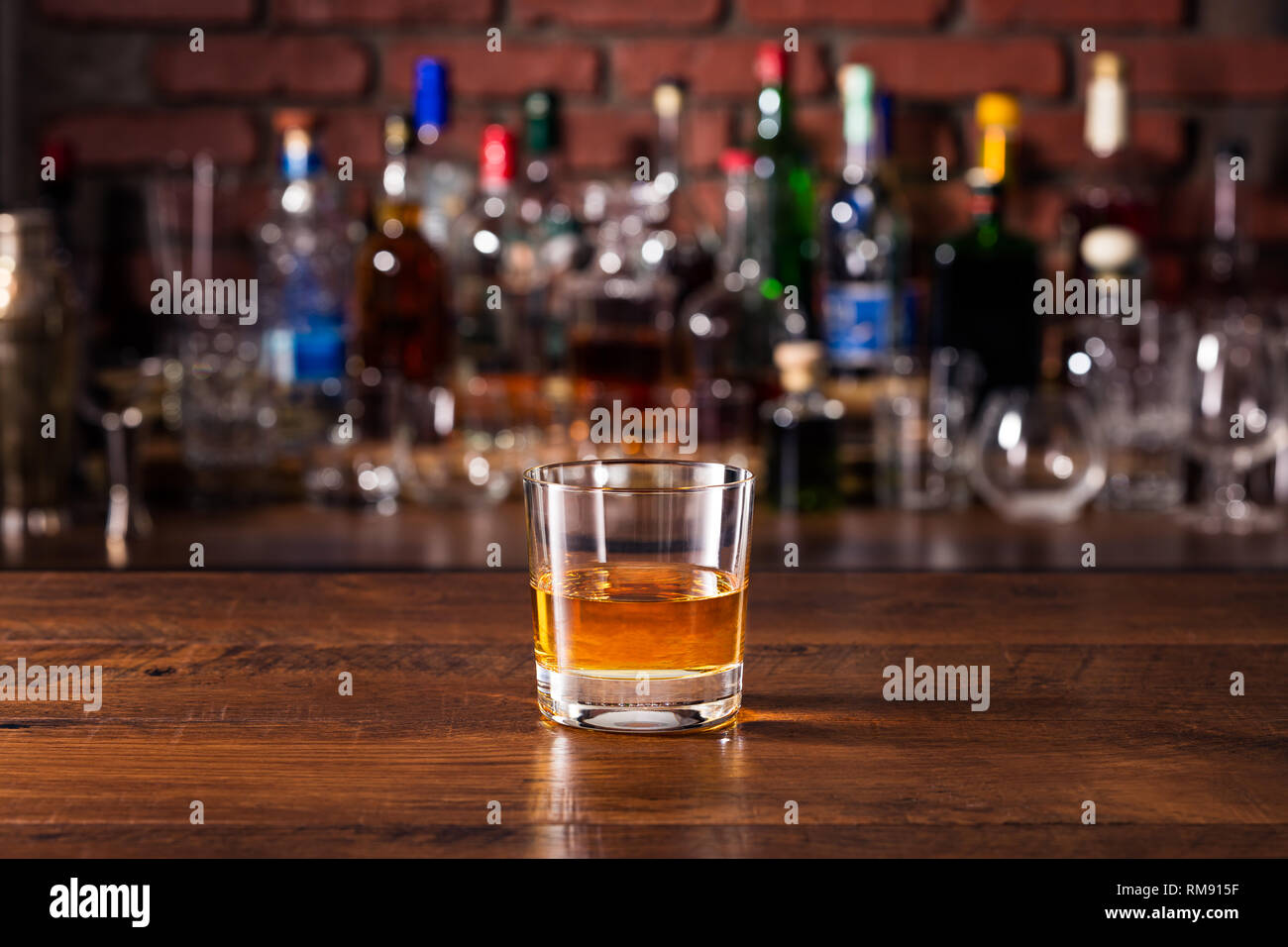 Refreshing Whiskey Neat Cocktail on a Bar - Stock Image