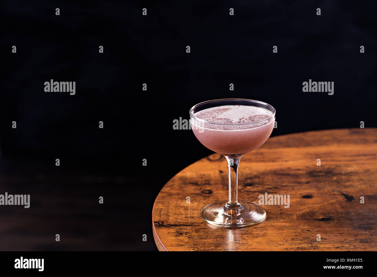 Refreshing Purple Aviation Cocktail on a Table - Stock Image