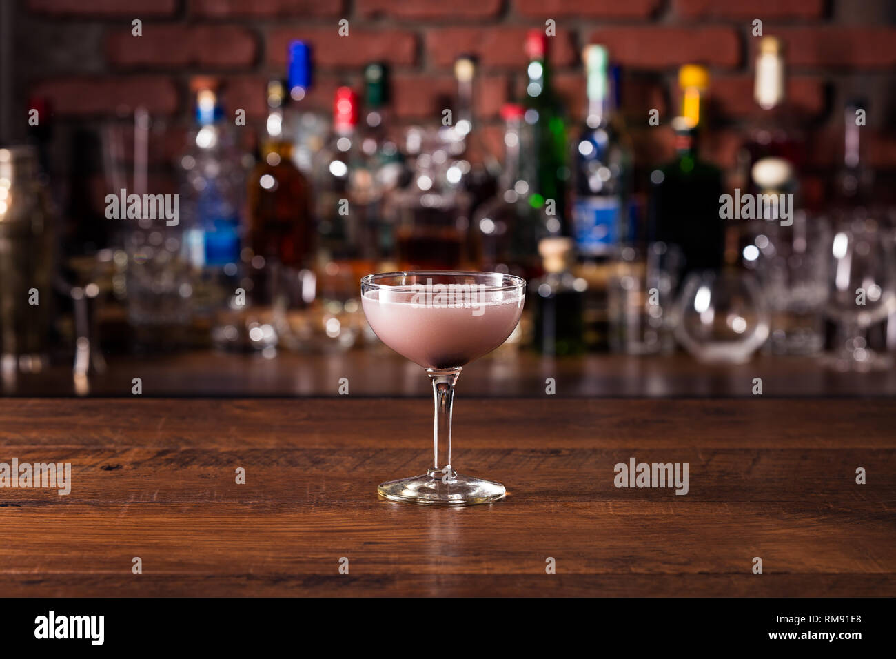 Refreshing Purple Aviation Cocktail on a Bar - Stock Image