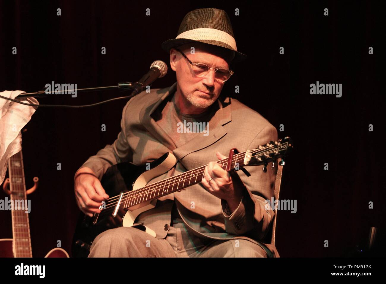SInger, songwriter and guitarist Marshall Crenshaw is shown performing on stage during a 'live' concert appearance. - Stock Image