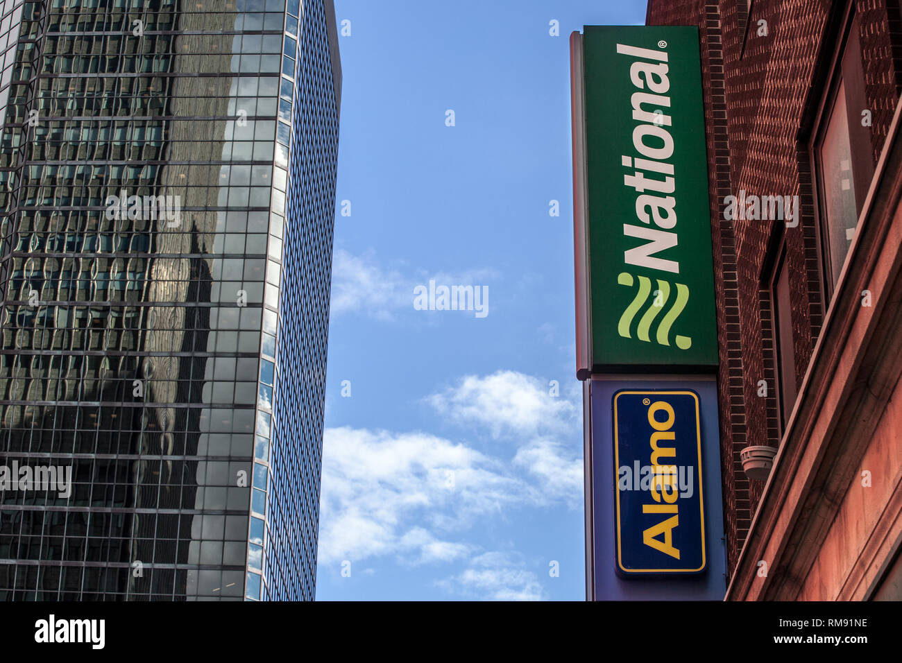 MONTREAL, CANADA - NOVEMBER 7, 2018: Logo of National Car Rental and Alamo on their main office for Montreal, Quebec. National and Alamo are car renta - Stock Image
