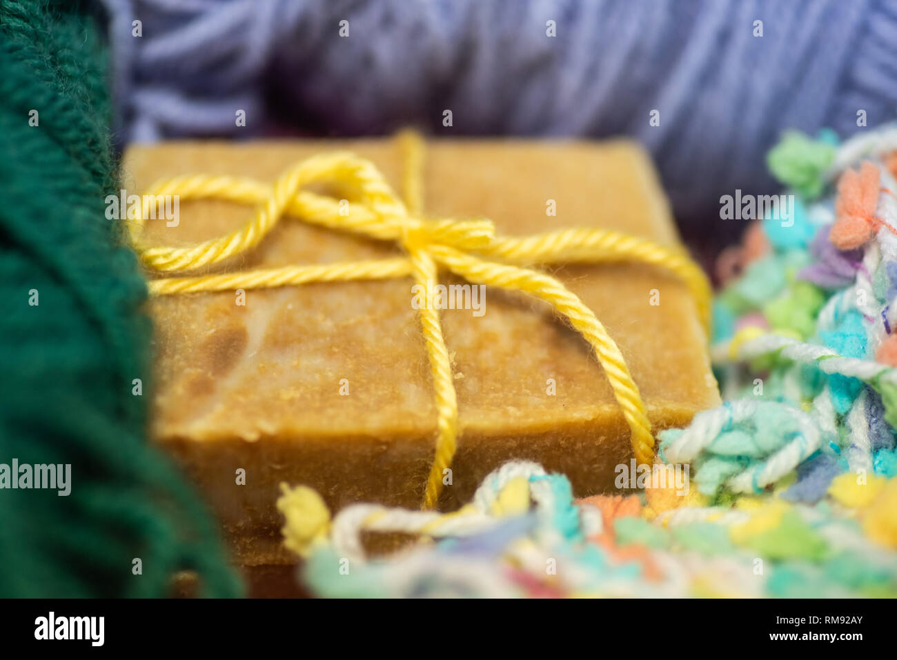 Bars of hand crafted soap with yarn. - Stock Image