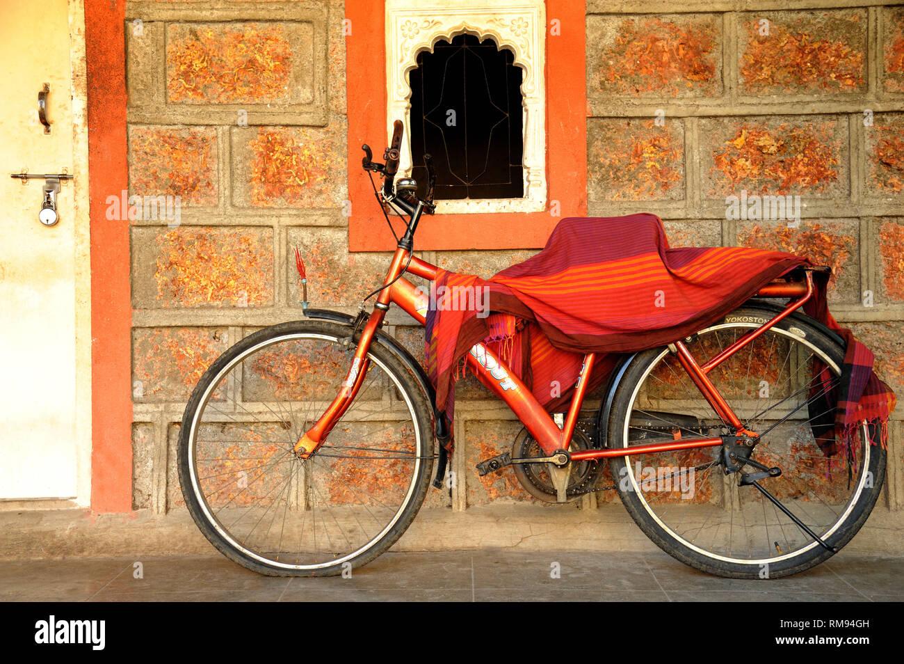 Bicycle parked outside of house, Maharashtra, India, Asia - Stock Image