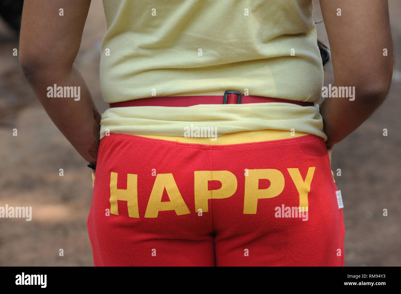 happy printed on pants back, India, Asia, MR#364 - Stock Image