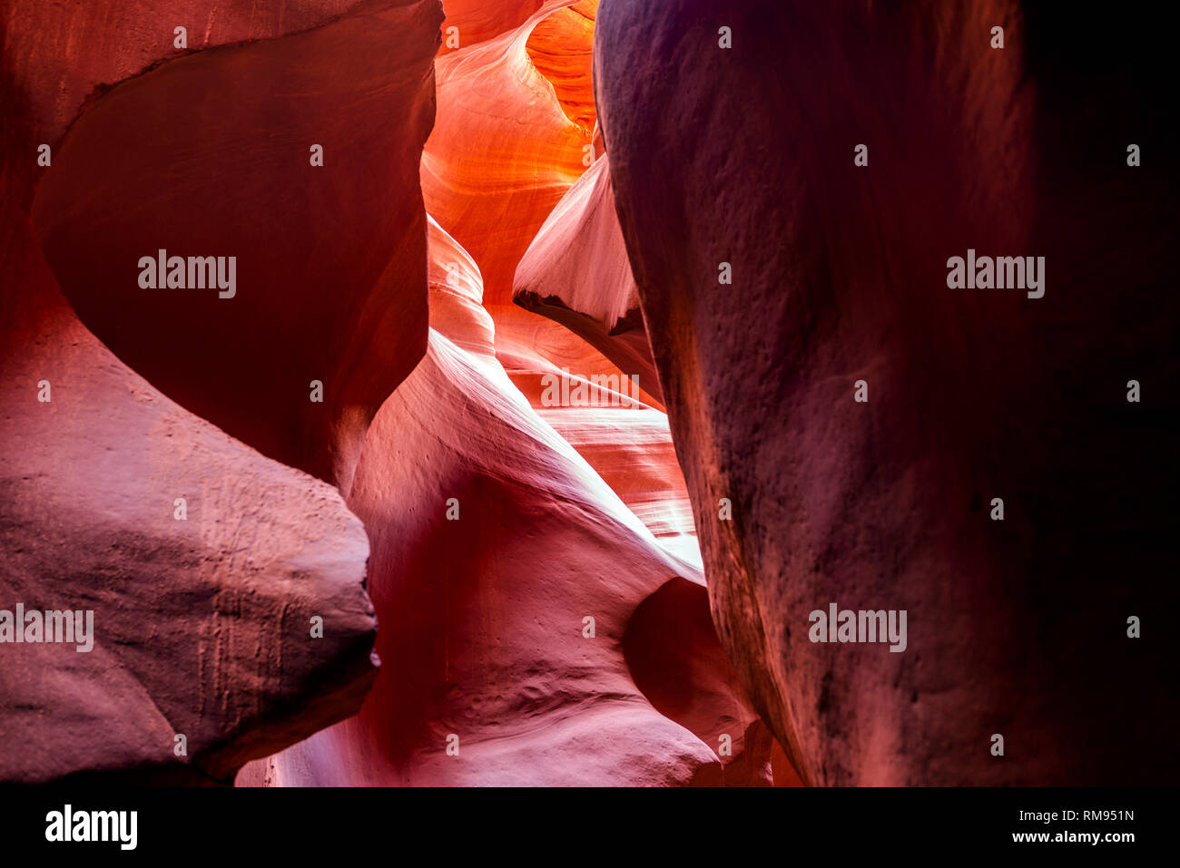 Abstract artistic waves of the colorful sandstone labyrinths of the slot Lower Antelope Canyon in Page city limit Arizona ignite the imagination of th - Stock Image