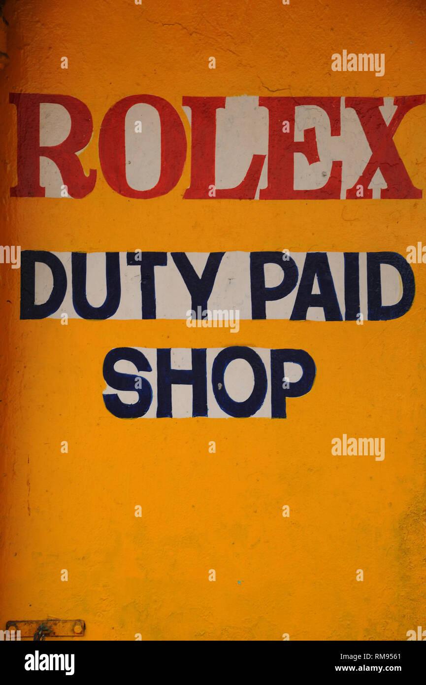 Rolex duty paid shop written on wall, kochi, kerala, India, Asia - Stock Image