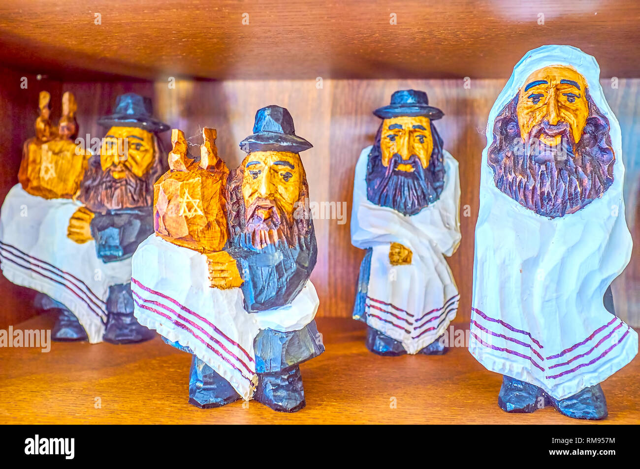 The small wooden figurines of the Rabbies, some of them with Scrolls of Torah, Krakow, Poland Stock Photo