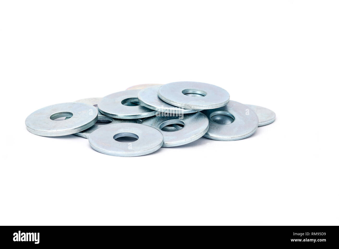 Stack of metallic steel fender washers for wood, isolated on white background - Stock Image