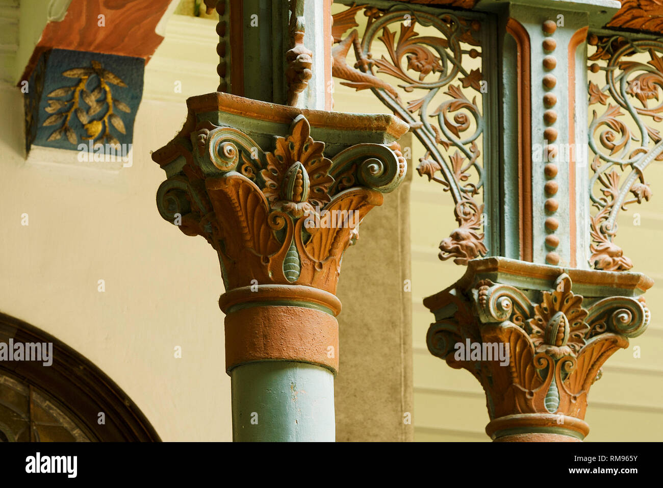 capitals of the cast iron columns in the main central courtyard in the Cheong Fatt Tze, The Blue Mansion in George Town, Penang, Malaysia - Stock Image