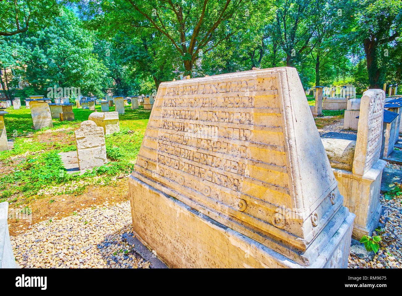 KRAKOW, POLAND - JUNE 21, 2018: The medieval preserved tombstone with large amount of inscriptions in old Jewish language,  on June 21 in Krakow - Stock Image