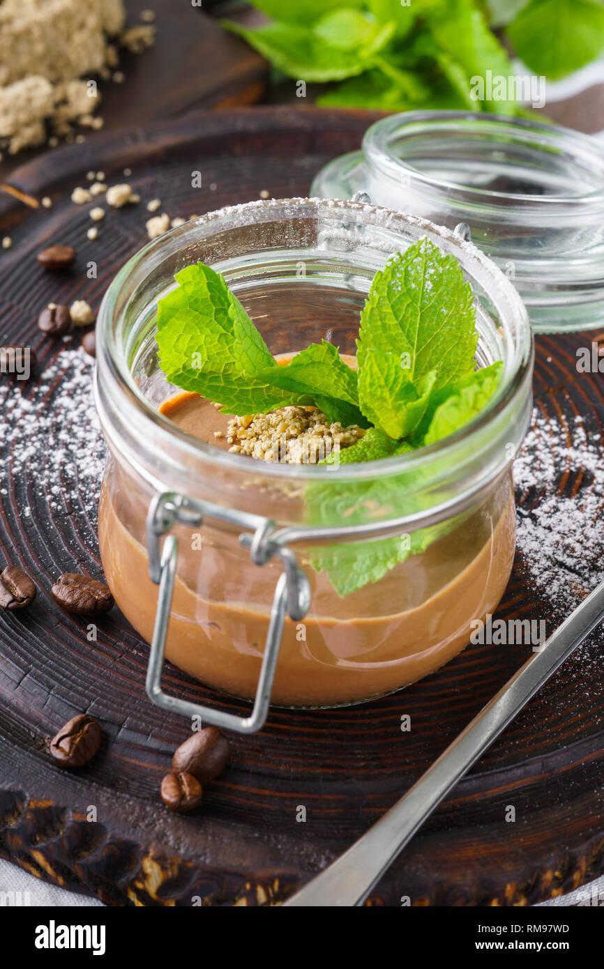 Healthy vegan chocolate pudding in a jar. Vegetarian dessert concept. - Stock Image
