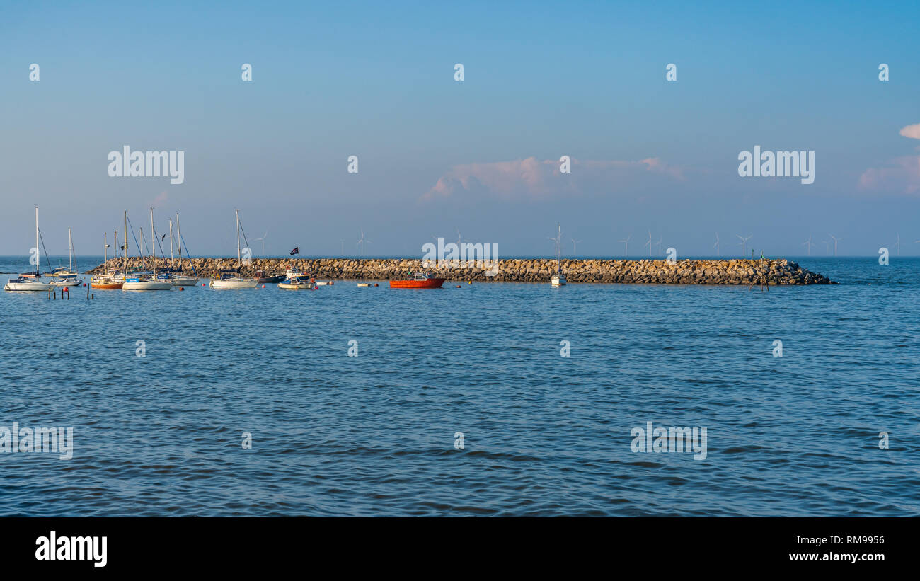 Rhos-on-Sea, Conwy, Clwyd, Wales, UK - June 09, 2018: Boats and a stone pier in the background - Stock Image