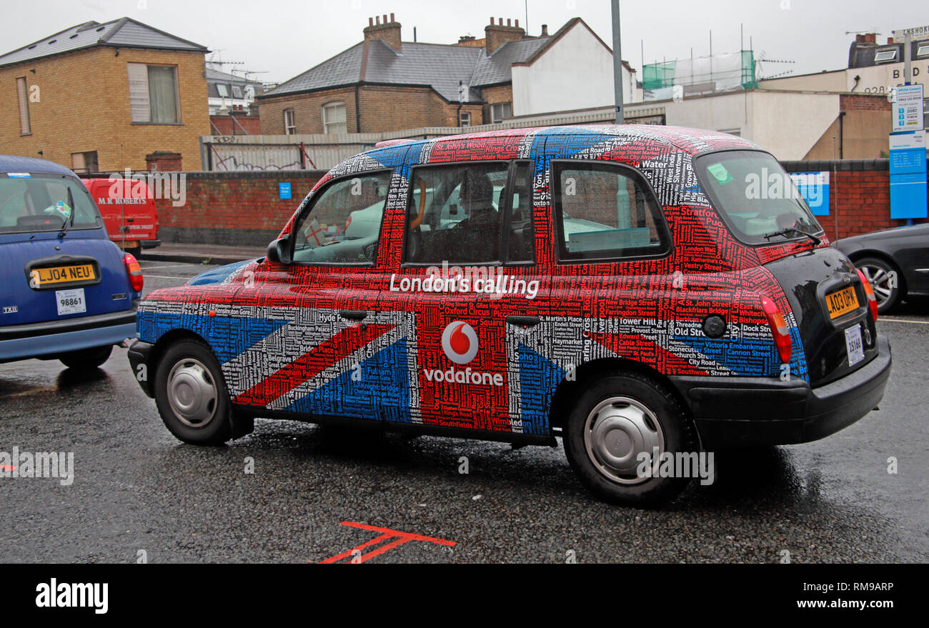 London Taxi Cab, in branded advertising livery Vodafone, Londons Calling, with Union Flag, Waterloo, Lambeth, South east England, UK - Stock Image