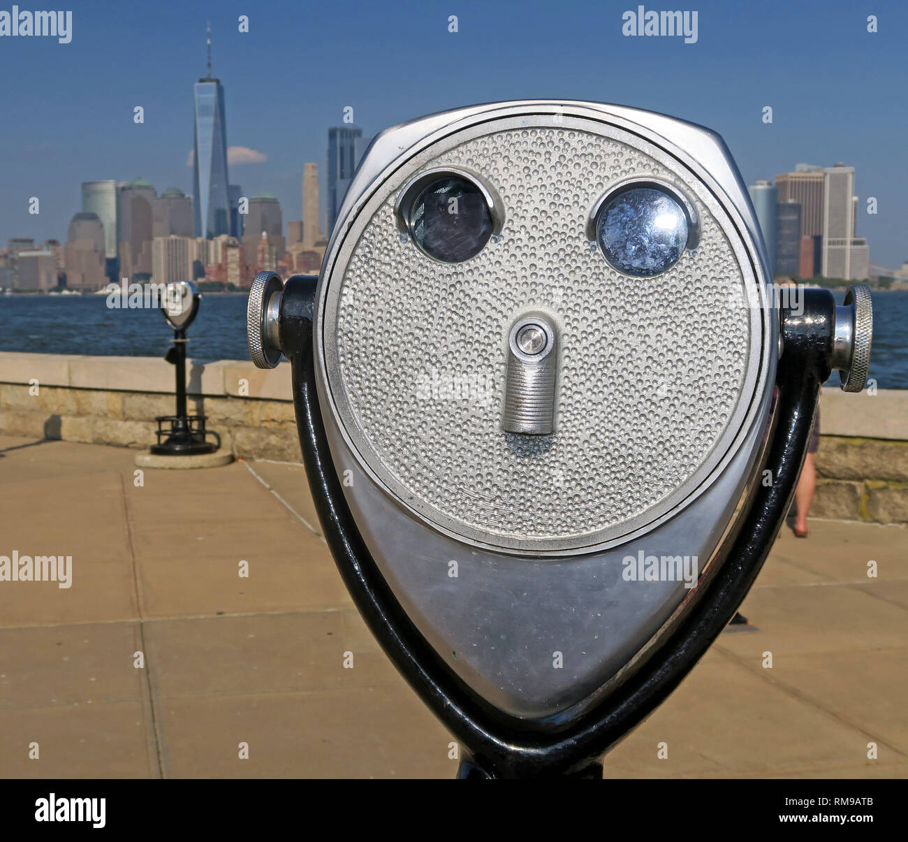 Silver / Steel PayToView coin operated binoculars, Ellis Island, New York Harbour, view of lower Manhattan, NYC, USA, United States of America Stock Photo