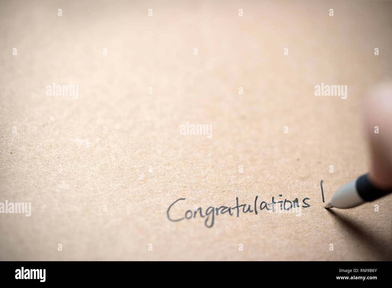 Hand writing congratulations note - Stock Image
