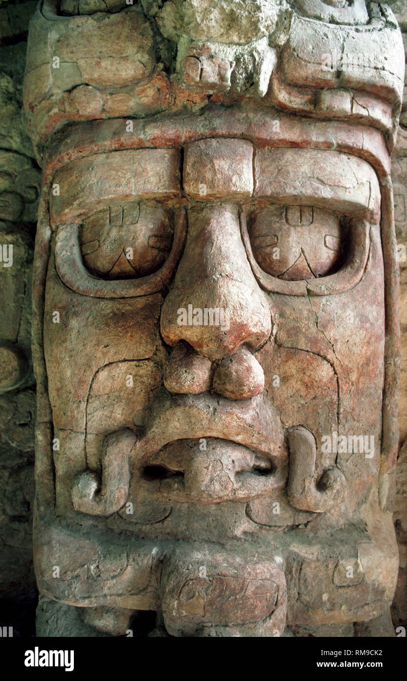 This is a close-up of one of five well-preserved stucco masks honoring the Mayan sun god Kin'ich Ahau at Kohunlich, an archaeological site on the Yucatán Peninsula in the state of Quintana Roo, Mexico. The 6- to 8-feet-tall (1.8 to 2.4 meters) sculpted masks flank the central stairway of a 6th-Century pyramid called the Temple of the Masks. - Stock Image