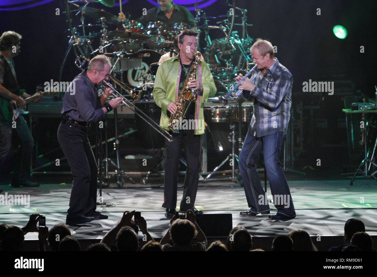 Chicago band members are shown performing on stage during a