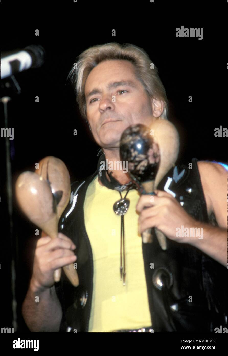 Musician Marty Balin of the Jefferson Starship is shown performing on stage during a 'live' concert appearance. - Stock Image