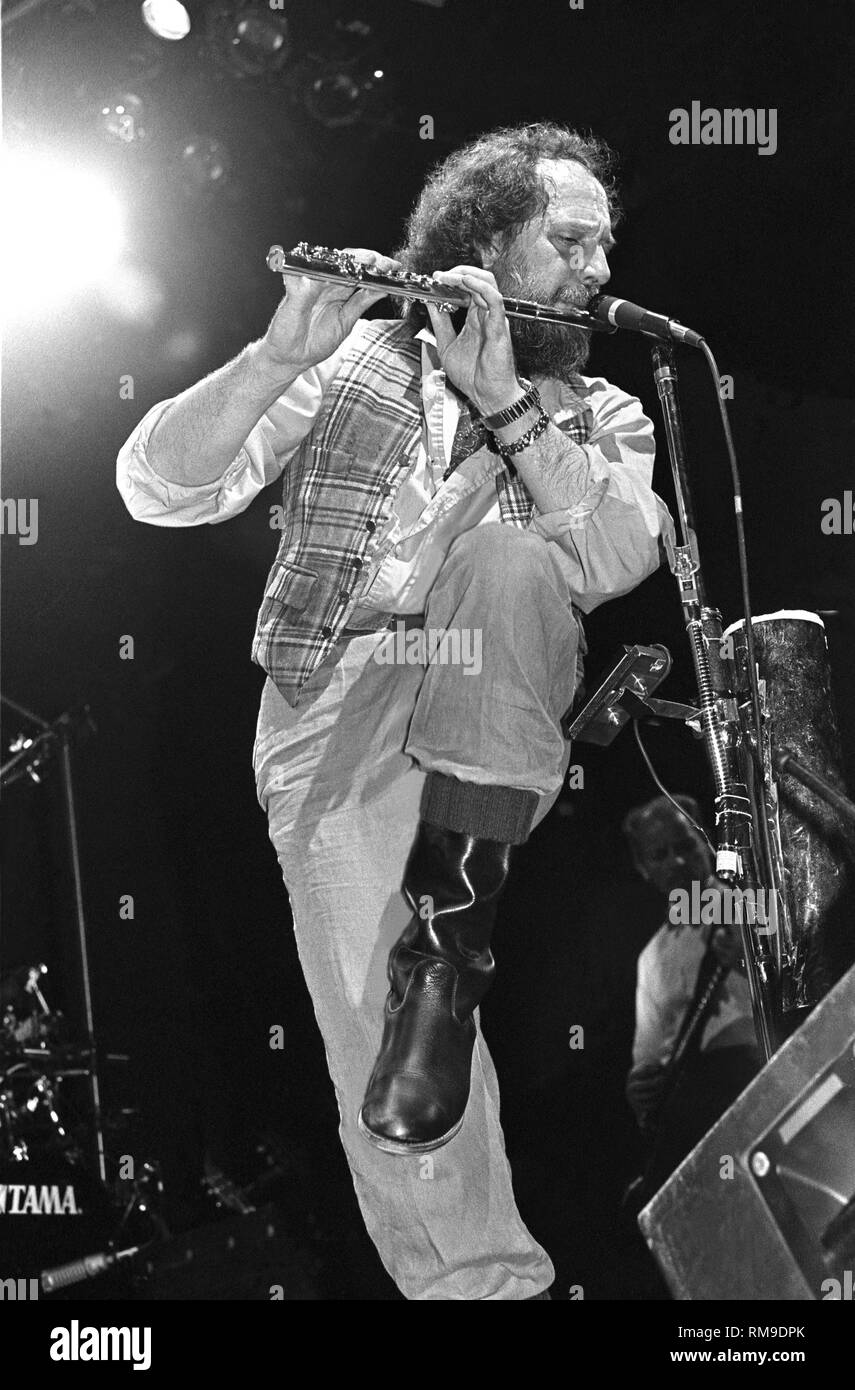 Musician Ian Anderson is shown performing on stage during a 'live' concert appearance with Jethro Tull. - Stock Image