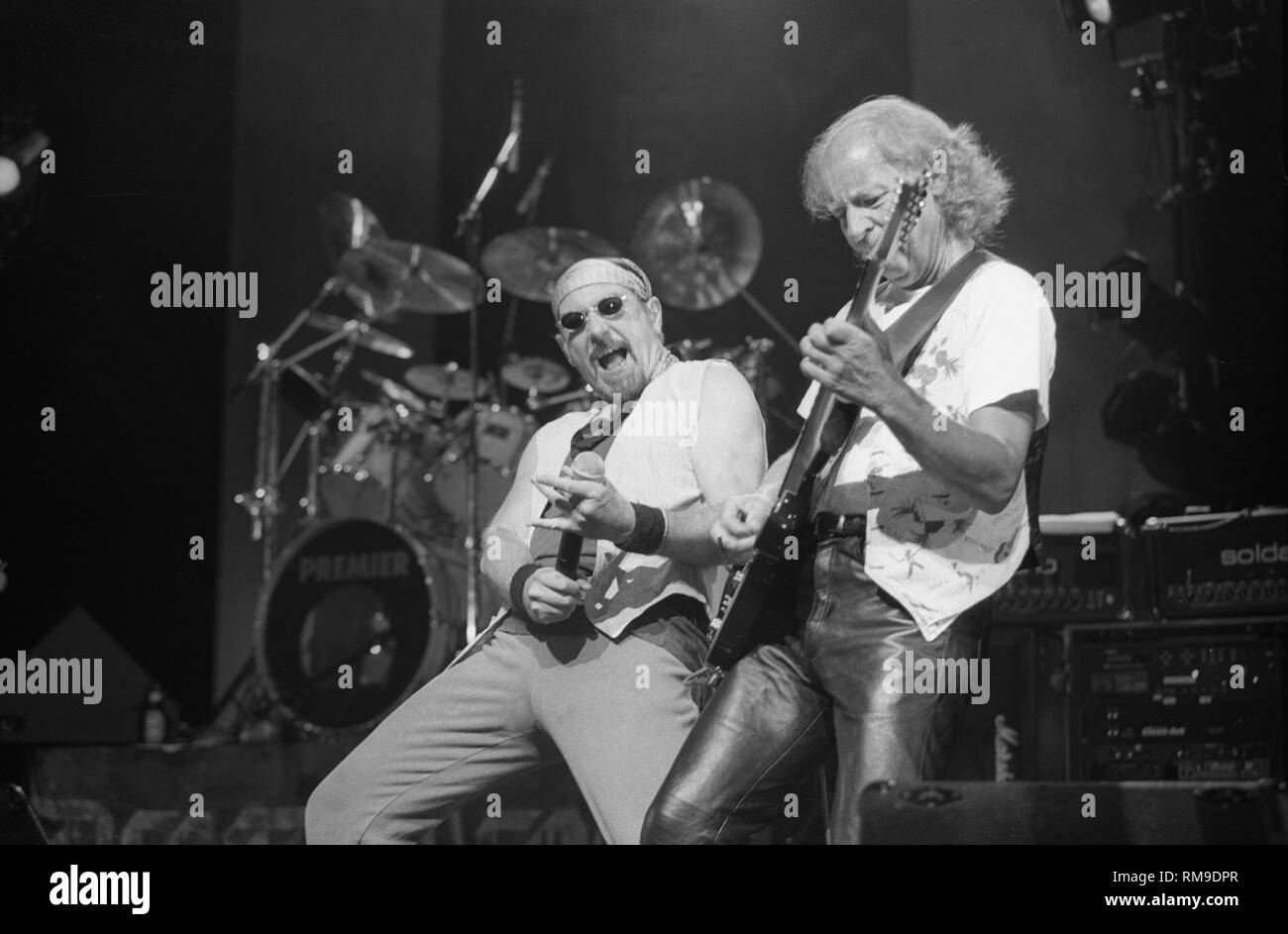 Ian Anderson and guitarist Martin Barre are shown performing on stage during a 'live' concert appearance with Jethro Tull. - Stock Image