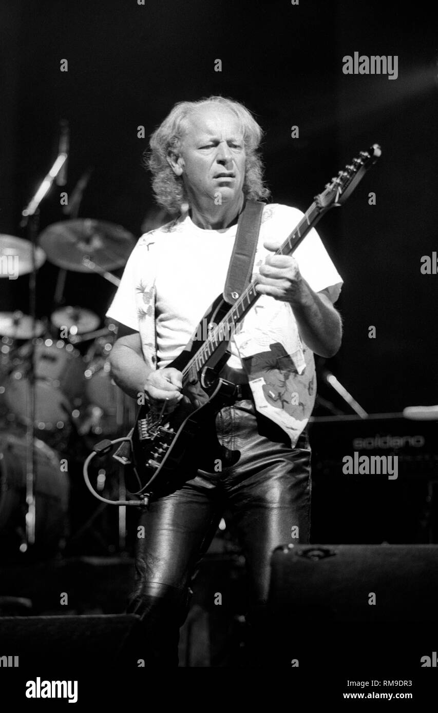 Guitarist Martin Barre is shown performing on stage during a 'live' concert appearance with Jethro Tull. - Stock Image