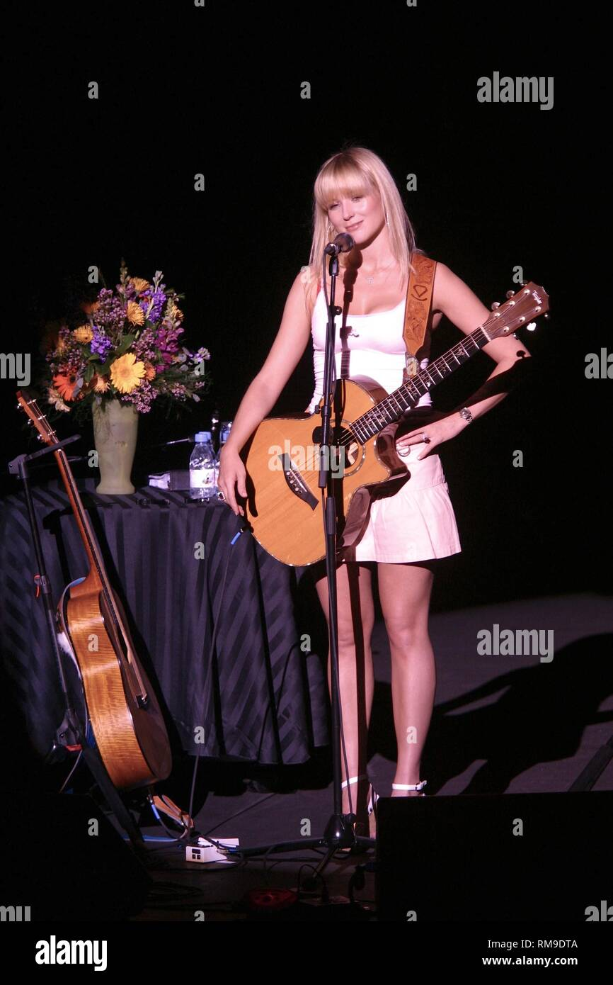 Singer, songwriter, actress, and poet, Jewel Kilcher generally known just by her first name Jewel, is shown performing on stage during a concert appearance. - Stock Image