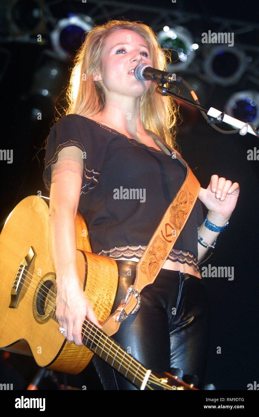 Jewel is shown performing on stage during a 'live' concert appearance. - Stock Image