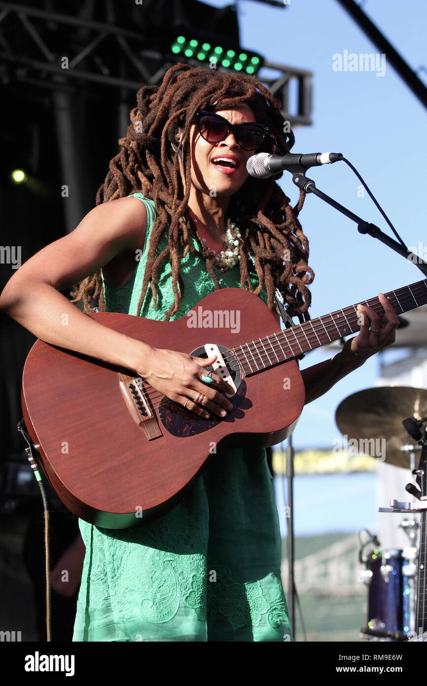Singer, songwriter and multi-instrumentalist Valerie June is shown performing on stage during a 'live' concert appearance. - Stock Image