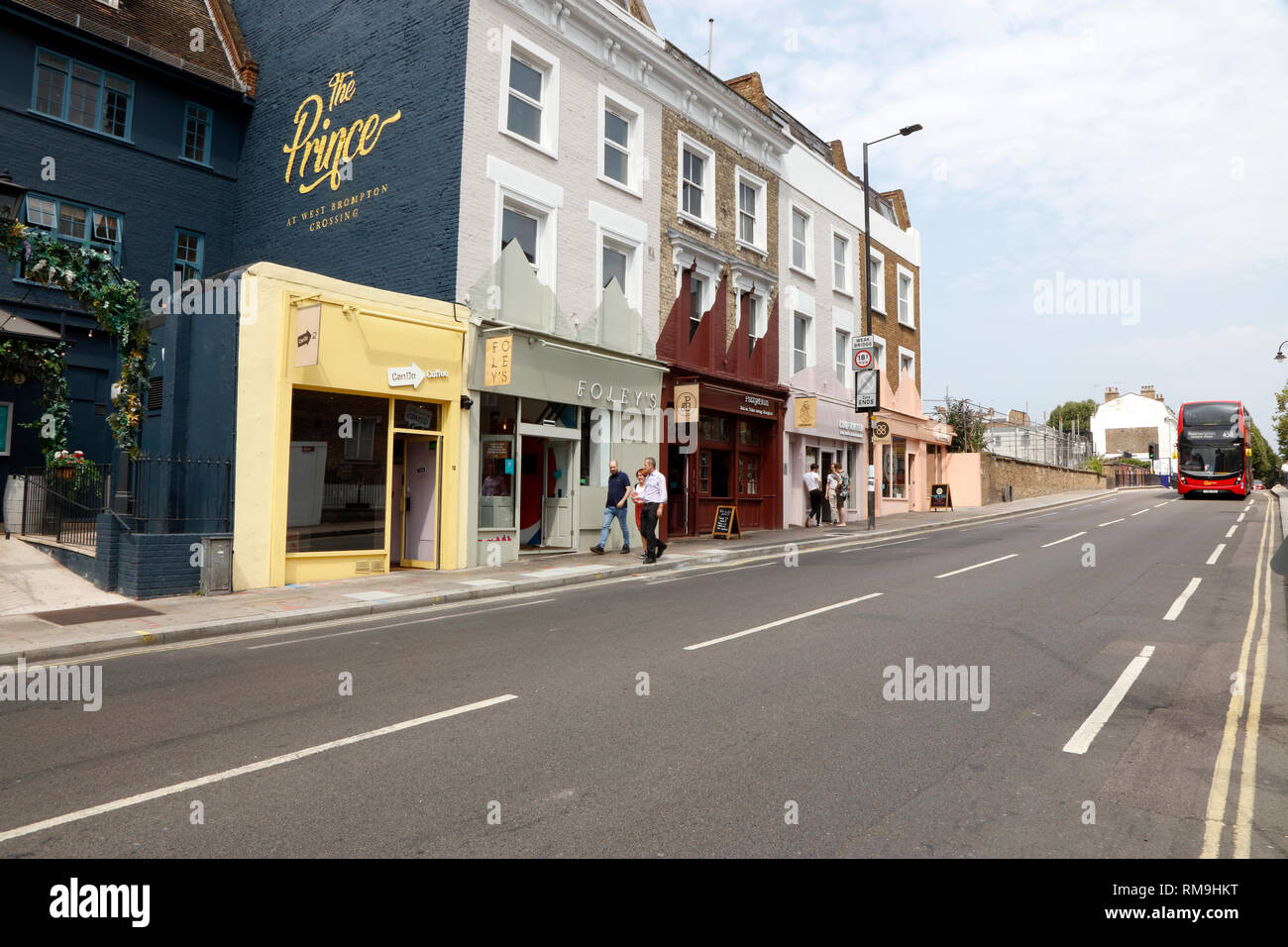 Cafes and restaurants on Lillie Road, West Brompton, London, UK - Stock Image