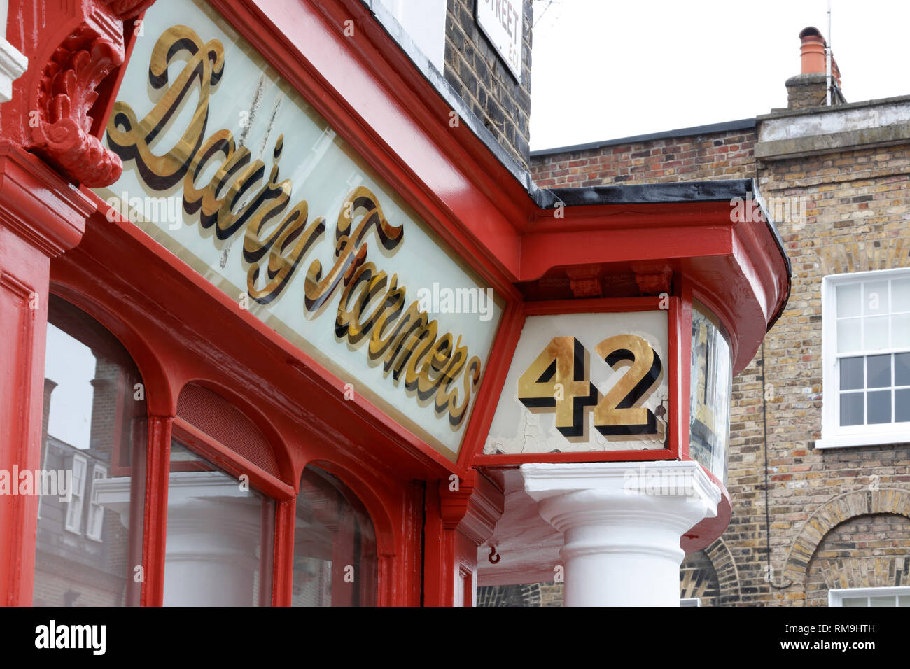 Facade of the old Lloyd & Son Welsh dairy on the corner of Amwell Street and River Street, Finsbury, London, UK - Stock Image