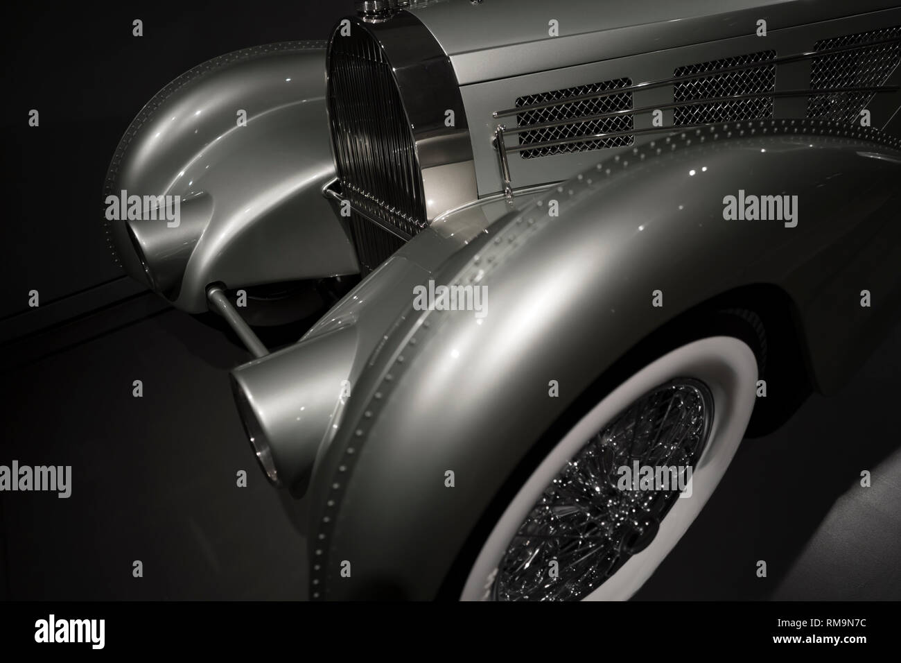 Old vintage car with a streamlined aerodynamic body shape with large fenders and convex headlights inherent in the design of retro cars, and with geom - Stock Image
