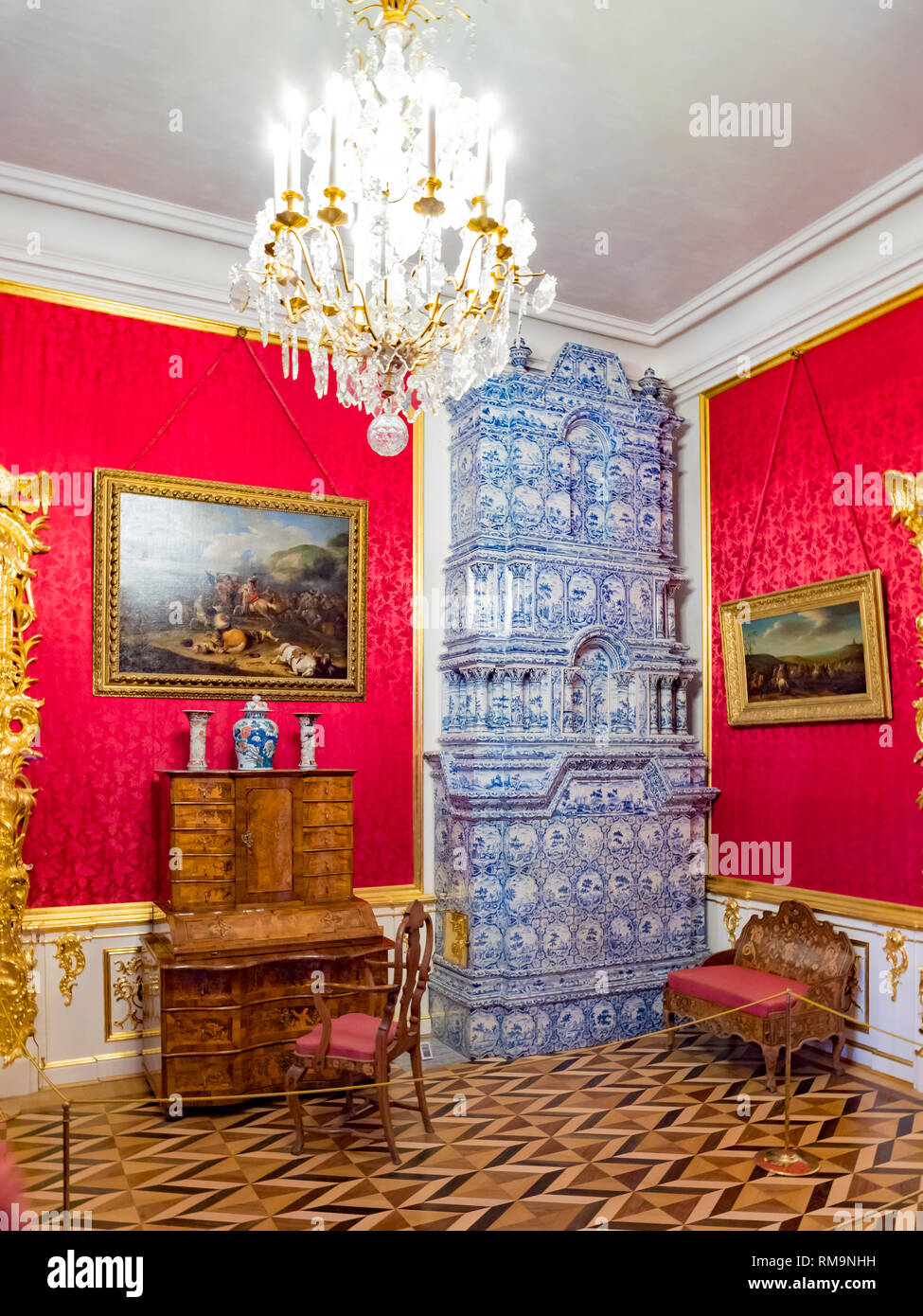 18 September 2018: St Petersburg, Russia - Room in the Peterhof Grand Palace with a ceramic tiled stove. - Stock Image