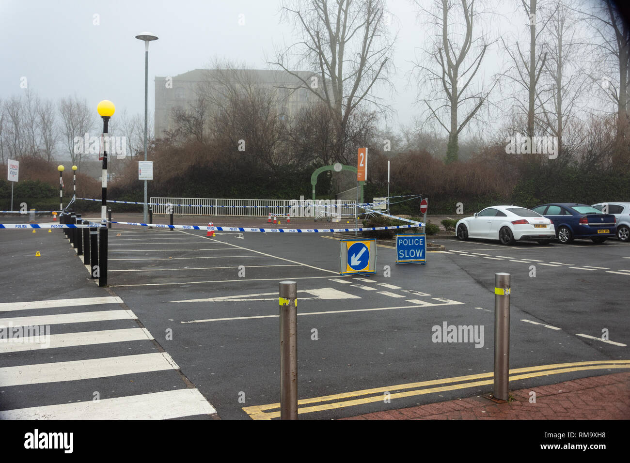 Trowbridge, Wiltshire, UK. 14th February 2019. Overnight there was a double stabbing near the Tesco Extra store. One victim rumoured to be critical. An overview of the scene from Tesco car park Credit: Starsphinx/Alamy Live News Stock Photo