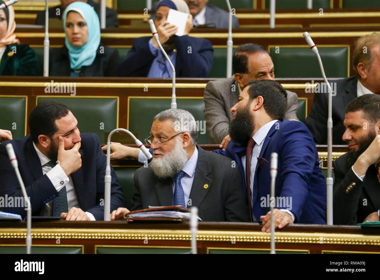 Cairo, Egypt. 14th Feb 2019. MPs of Al-Nour ultra-conservative Islamist party attend a session of the Egyptian Parliament during which Parliament members are voting on the proposed constitutional amendments that will increase the country's President term in office from four to six years after deliberations. If MPs voted in favour, the amendments will be referred to the Legislative and Constitutional Affairs Committee to be discussed in detail and finalized before being referred to the President to be put up for a public vote in a national referendum.Credit: dpa picture alliance/Alamy Live News - Stock Image