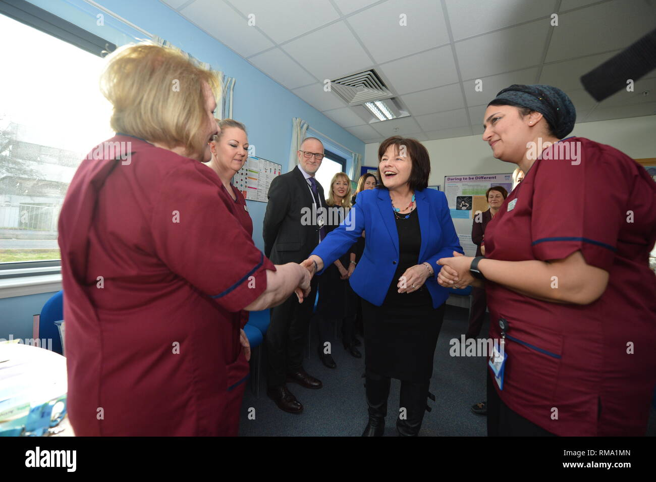Kilmarnock, UK. 14 February 2019.(L-R) Linda Rimmer - Midwife; Jean Davis - Midwife; Colin McDowall - Chief Executive South Lanarkshire Council; Health Secretary - Jeane Freeman; Attica Wheeler - Head of Midwifery Associate Nurse Director, NHS Ayrshire and Arran. Transforming maternity and neonatal care across Scotland Cabinet Secretary for Health Jeane Freemanl visits Crosshouse Hospital in NHS Ayrshire and Arran to announce a £12 million investment which will ensure mums, babies and other family members are all supported from pregnancy to birth and after. This includes testing a new model - Stock Image