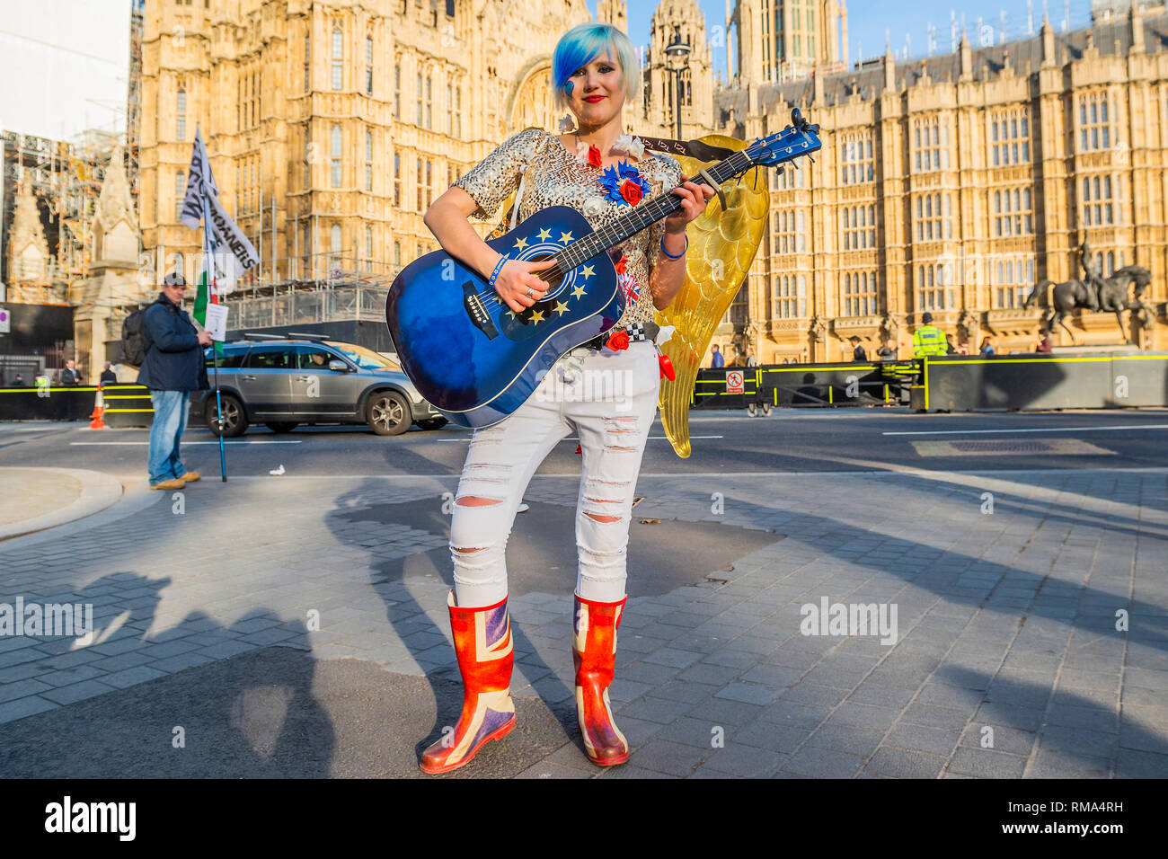 London, UK. 14th February, 2019. A singing angel leads the way to heaven, for remainers - Sodem pro EU protestors outside Parliament - Leave means leave and SODEM, pro EU, protestors continue to make their points, side by side, outside Parliament as the next vote on Theresa May's plan is due this evening. Credit: Guy Bell/Alamy Live News - Stock Image