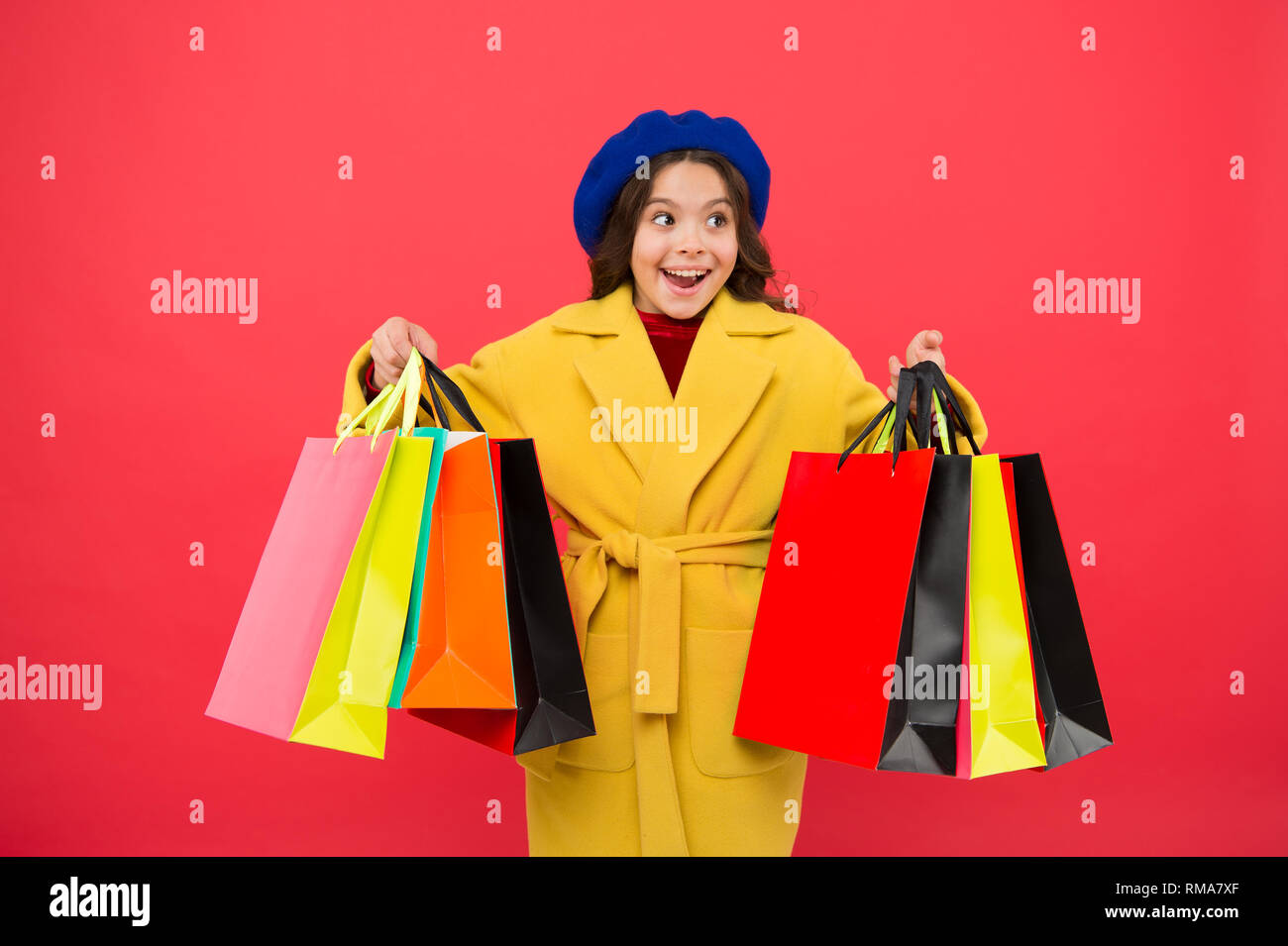Customer satisfaction. Prime time buy spring clothing. Obsessed with shopping. Girl cute kid hold shopping bags. Get discount shopping on birthday holiday. Nice purchase. Fashionista enjoy shopping. - Stock Image