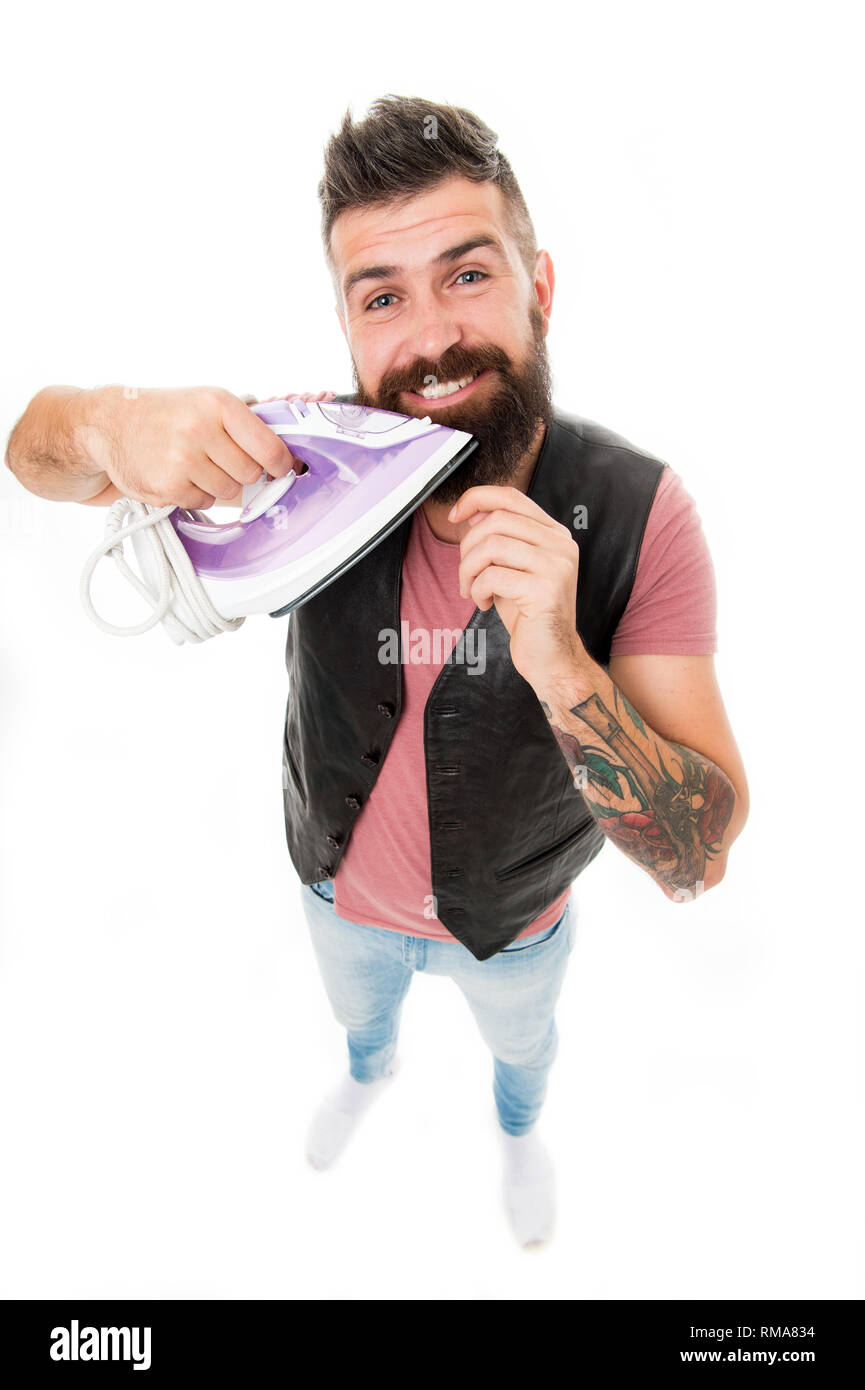 Iron for styling hair. Man styling beard with electric ironing tool. Barbershop concept. Beard styling and grooming salon. Hipster well groomed bearded hold iron. Beard grooming tips. Amateur barber. - Stock Image